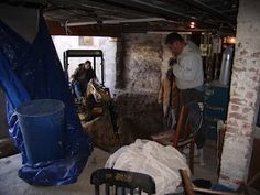 Using the mini excavator to lower the existing basement floor