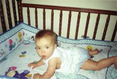 Michaela with bumper pads in her crib