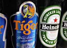 Bottles of Tiger and Heineken beers are pictured on the shelf of a grocery store in Singapore