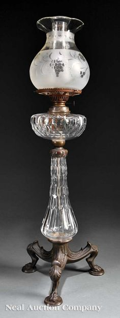 An American or English Patinated Bronze and Cut Glass Banquet Lamp, tripartite paw foot base, cut and etched shade, chimney