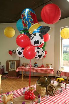 Balloon decorations at a cowboy birthday party! See more party planning ideas at CatchMyParty.com!