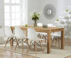£599 for the whole set  Buy the Verona 150cm Solid Oak Extending Dining Table with Charles Eames Style DSW Eiffel Chairs at Oak Furniture Superstore