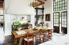 Kitchen: Architectural Digest A portrait overlooks the kitchen table, which is surrounded with antique French chairs; the range is by La Cornue, and the custom-made doors feature hardware by the Nanz Co. Architectural Digest, French Country Kitchens, French Country Decorating, Country French, Country Style, French Style, European Kitchens, French Countryside, Küchen Design