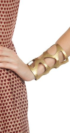 Gold cuff with cut outs available only at Pernia's Pop-Up Shop.