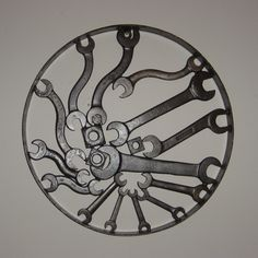 "Wall Hanging, antique wrenches n wagon wheel rim, 19 1/2"" dia."