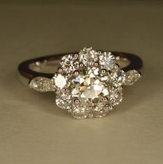 Handmade Art Deco Diamond Flower Engagement Ring 14k & by JdotC So much character in this ring!