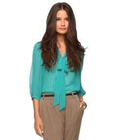 Teal blouse. Great shirt for work tucked into a cobalt blue skirt or a flowy white one for a weekend look