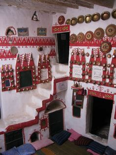 """Ghadames, the pearl of the Libyan Sahara, the Berber Oasis: Tuareg traditional red and white paint wall designs, roof paths, covered streets, ancient city of Ghadames."" via https://www.facebook.com/pages/Suppressed-Histories-Archives/333661528320"