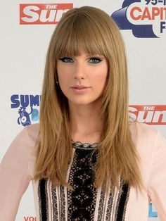 Taylor Swift long, straight haircut with blunt, straight-across bangs | allure.com