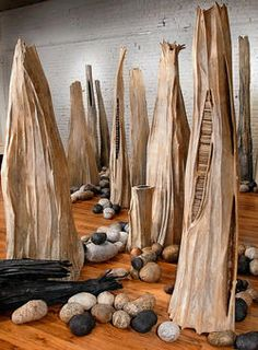 "by Jo Stealey, ""Forest"", 2008, over-beaten flax, abaca, and willow armature, dimensions variable."