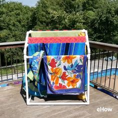 Build this handy towel rack from ordinary PVC plumber's pipe. The rack can hold eight full-size beach towels, and, as a bonus, it corrals all the pool noodles and floaties. landscaping videos How to Build a PVC Pool Towel Rack Pool Towel Holders, Towel Rack Pool, Pool Towels, Outdoor Towel Racks, Beach Towel Storage, Pool Float Storage, Above Ground Pool Slide, Piscina Diy, Pool Deck Decorations
