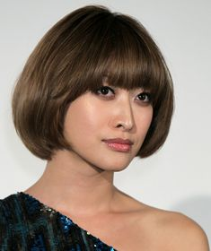 Rounded bob with bangs.