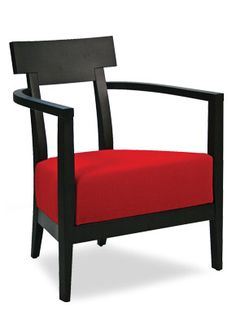 """A low arm chair with clean modern lines and an open back  [share title=""""Share with friends"""" socials=""""facebook, twitter, google, pinterest, bookmark"""" class="""""""" icon_type="""""""" ]"""