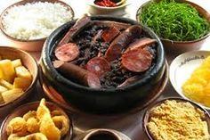 Feijoada (typical Brazilian food: black beans, pork and some accompaniments)
