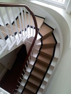 Love the stair runner with brass accessories!