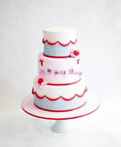 What a sweet little cake this is with flowers and gingham! #dessert #party