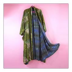 Amazing reversible vintage duster!  Stunning batik printing on both sides!  Gorgeous color combinations.  Avant garde oversized long shape with drop shoulders.  Two front patch pockets and an inverted pleat on back.  Effortless and timeless just how we like it.Never worn condition!  One Size fits all Hand Wash Line DryHere's a little history on these Batik and some other 80's coats we're adding the shop:A friend of mine who is a designer lived in Indonesia in the 80'...