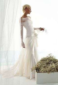Le Spose Di Gi�. Long sleeves, chiffon and lace dress, with organza over skirt.