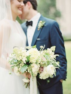 Bride and groom. Bride's dress by Romona Keveza. Bouquet by Rosegolden Flowers. Image by Ryan Ray.