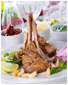 Mutton chops prepared and styled in a fusion Indian-inspired preparation for a direct marketing brochure.