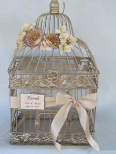 Hey, I found this really awesome Etsy listing at http://www.etsy.com/listing/112801349/champagne-birdcage-wedding-card-box