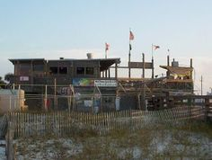 Flora-Bama Lounge - This quirky beach side landmark on the Florida-Alabama state line was my inspiration for the Sand Crab where Lily ran into Will in chapter 22 (Be There or Be Square) in the novel, Lily in Bloom Flora Bama, East Coast Beaches, Beach Bars, Cool Bars, Alabama, Places Ive Been, Trail, Florida, Bloom