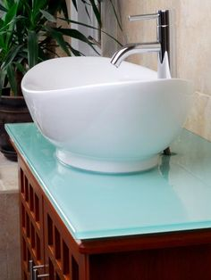 No matter the style, a vessel sink will add a touch of elegance. Vessel sinks — in stone, glass and metal — have come down in price since they first became popular. Smaller bowls are perfect for half bathrooms and powder rooms.