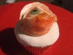 Infected Eye Cupcake Gift Set -   Large flavour cupcake with hidden blood (flavoured filling), infected eyeball topper, additional puss & 'antibiotic' syringe. The eyeball topper comes unattached to the top of the cupcake and can be eaten on its own, used as a topper for another item and can also be secured to the top of the cupcake using the puss.