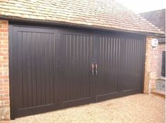 Wooden bi-fold garage doors with draught excluded frames are ideally suited for a climate controlled garages. These folding garage doors are also available as bespoke doors. Garage Door Framing, Garage Door Track, Overhead Garage Door, Wood Garage Doors, Garage Door Design, Front Door Design, Front Door Paint Colors, Painted Front Doors, Garage Door Torsion Spring