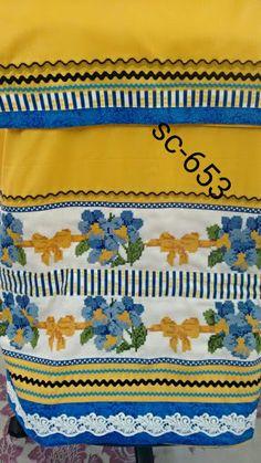 a yummy mango with 2 borders of flowers n bows x stitch....
