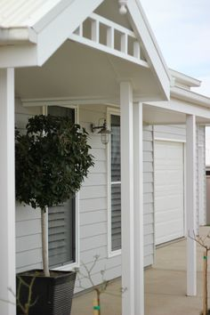 EXTERIOR COLOUR: Mid grey Colorbond roof, white trims and light grey Colorbond cladding with greyed timber decking. I also like the decorative insert in the gable White Exterior Houses, Grey Exterior, Grey Houses, Cottage Exterior, House Paint Exterior, Exterior House Colors, Exterior Design, Weatherboard Exterior, Exterior Cladding