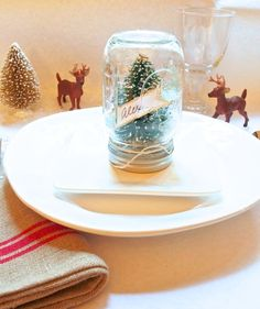 Make these little snow globes as DIY holiday place cards. Annette Joseph Style has the tutorial. || @ajosephstyle