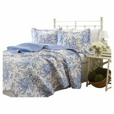 "Adorned with a toile-inspired floral motif, this quilt set is crafted from cotton for comfort with a touch of garden style. Product: Twin: Quilt and standard shamFull/Queen: 1 Quilt and 2 standard shamsKing: 1 Quilt and 2 king shamsConstruction Material: CottonColor: Blue and whiteFeatures: ReversibleDimensions: Twin Quilt: 88"" x 68"" Full/Queen Quilt: 90"" x 90King Quilt: 96"" x 104"""
