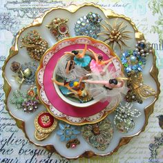 Yummy.....egg plate with vintage jewelry and tiny ballerina figures