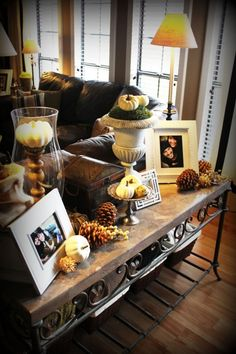 fall decor, Holidays Design - love the idea of mini pumpkins and pinecones - must do this for my sofa table