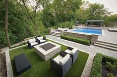 Gorgeous installation done by one of our dealers around a pool. www.easyturf.com l modern l design l outdoor living l pool l artificial grass l fake grass l easyturf