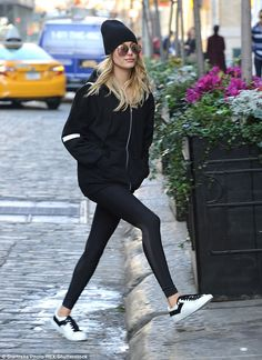 On the go: Hailey Baldwin was spotted in a casual black and white look while out and about in New York City on Thursday