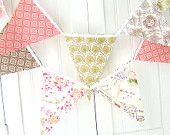 Love having fabric as bunting, wanting to put the letters of the name or something on it and hang it somewhere in the nursery