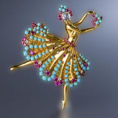 """A diamond, ruby, and turquoise """"Clip Danseuse"""" brooch, Van Cleef & Arpels, 1943, designed as a ballerina with pear-shaped rose-cut diamond face, her tiara, skirt and bouquet accentuated by circular-cut rubies, old European and single-cut diamonds, and cabochon turquoise; signed Van Cleef & Arpels, N.Y. no. 4157; mounted in eighteen karat gold; length: 2 3/4 in."""