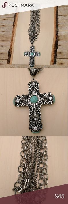 Rustic Silver and Turquoise Cross Necklace Rustic Silver and Turquoise Cross Necklace * Excellent used condition * Siver tone 6 strand  * 21 inches chain and lobster claw clasp * Turquoise and Crystal cross * Gorgeous scroll detailing * Boho chic * Cowgirl chic * Southwest Jewelry Necklaces