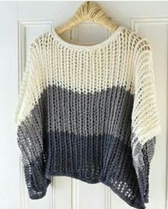 Depending on whether you knit this pattern with a cotton-linen blend or a sparkly metallic yarn, this topper could take you from the beach to the ballroom. The poncho styling can be worn with the… Poncho Knitting Patterns, Knitted Poncho, Knit Patterns, Knit Shrug, Hand Knitting, Easy Crochet, Knit Crochet, Metallic Yarn, Universal Yarn