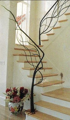 I love this custom made natural tree staircase. Staircase railing is usually just.staircase railing, but this railing is different and unique! This is great for a rustic, country, and even modern decor look. Banisters, Stair Railing, Hand Railing, Staircase Handrail, Stair Idea, Iron Staircase, Iron Balusters, Spiral Staircases, Stairway To Heaven