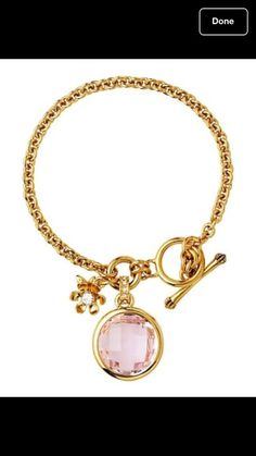 """Juicy Couture Gemstone Mini Charm Bracelet  YJRU6322 Retail $48+ tax  Like the necklace and earrings it complements, these bracelets feature a sweet little charm matched to a vibrant faceted stone. Choose a crown, feather, flower, bird, or skull charm hanging on a pretty gold chain. Toggle closure.  Brass/glass/cubic zirconia  This is for the Pink with Flower  Imported  7.3""""L"""
