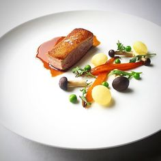 Roasted duck breast, honey glazed carrots, pommes soufflé, brown cap boletus, fresh peas, duck glaze by @ma_pasion ⭐️ Cookniche.com for more culinary inspirations.
