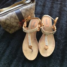 """Embellished Thong Sandals  Pre-owned in good condition, see photos for light wear. The heel is about an 1"""". I have a bundle discount and hundreds of lovely listings in all different sizes! My closet is full of tops, dresses, scarves, jackets, coats, sweaters, skirts, handbags, shoes and formal wear. I do not accept offers on items $10 or less, please make a bundle if you want a discount.  I normally ship within a day. Let me know if you have any questions.  -Zahadi Bucco Shoes Sandals"""