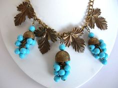 1930s Czech Necklace with Brass Leaves, Bell Caps & Turquoise Glass Beads. Large bell bead caps with opaque blue glass dangles.