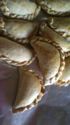 Easiest pineapple empanadas ever.  Dough; 1lb Butter, 1-8oz Cream Cheese, 2 eggs and 2lbs of flour. Mix until dough forms then section out to desired size roll out and fill.  Filling is up to you are, I used pineapple preserve. When your enpanadas are done brush with egg wash and bake at 350° for 40 minutes and enjoy.