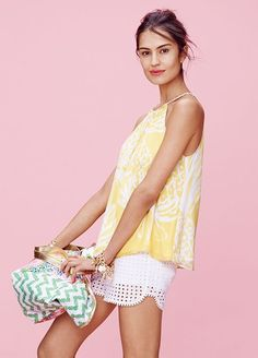 Every Single Piece From The Lilly Pulitzer x Target Collection #refinery29  http://www.refinery29.com/2015/03/84530/lilly-pulitzer-target-collaboration-lookbook#slide-7  Lilly Pulitzer for Target Halter Top - Pineapple Punch, $26; Eyelet Shorts - White, $26; Canvas Shopping Tote - Nosie Posey and Belladonna, $15; Charm Bracelet - Gold, $20, available at Target.