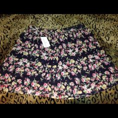 NWT Floral Mini Skirt  This skirt has a shear overlay with a solid black panel underneath & a small zipper in the back. New with tags purchased from Windsor WINDSOR Skirts