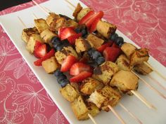 making breakfast fun! french toast, bananas, strawberries, and blueberries all on a stick. yum!